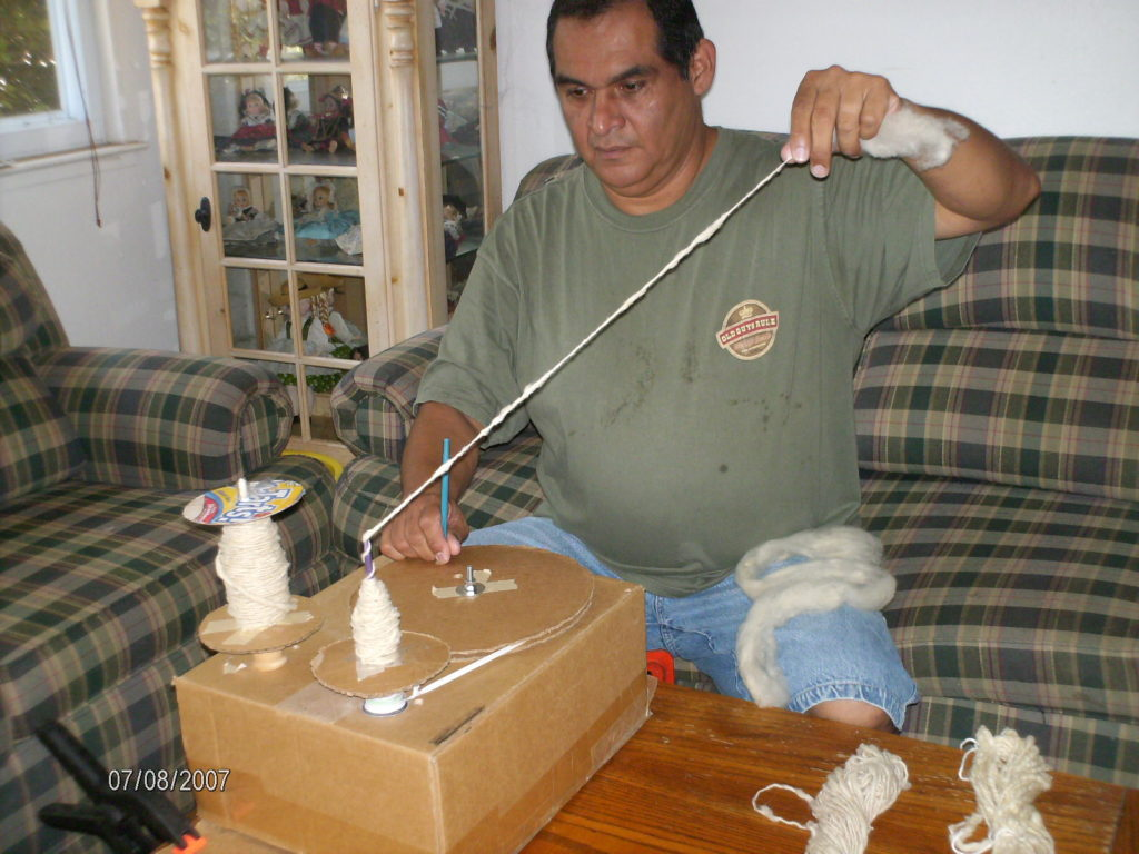 He Built a Cheap Spinning Wheel With Cardboard