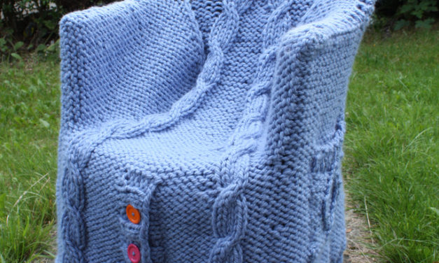 A Cable-Knit Cardigan Fit For a Chair …