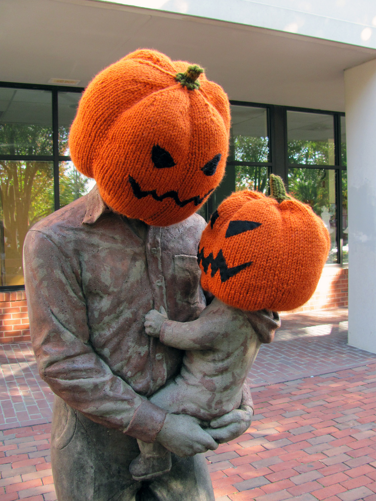 My Favorite Halloween Pumpkin Yarn Bomb - Daddy and Baby Pumpkin Heads Hugging!