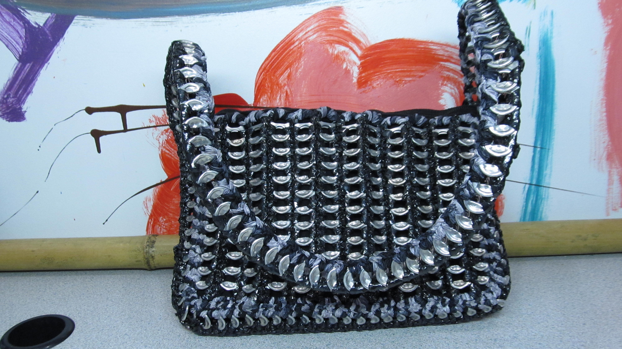 She Crocheted a Soda Pop Can Tab and VHS Tape Purse