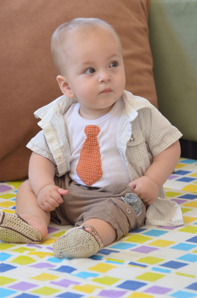 Cute and Clever! Crochet Tie on a Baby's Onesie