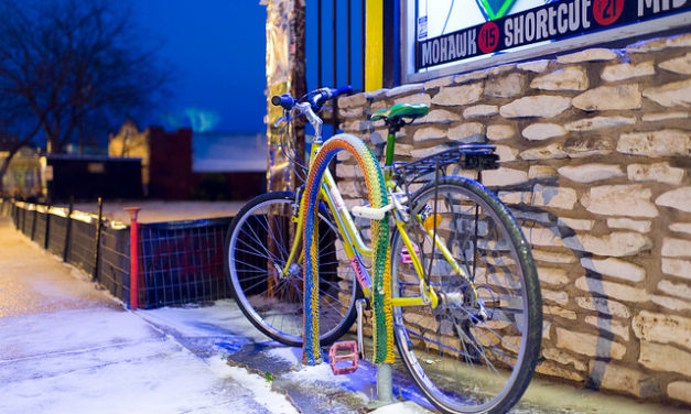 Snow in East Austin. Yarn Bomb. Excellent photograph. Layers and layers of subtext. Wow!