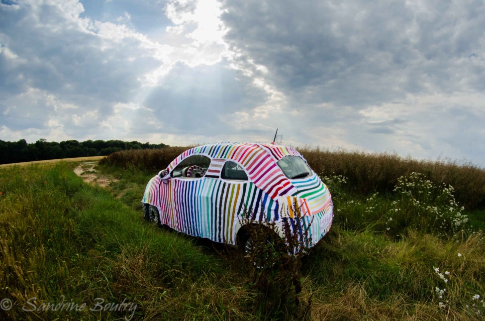 Sandrine Boutry's #SecretStripyProject is … a Yarn Bombed Car, Inside and Out!