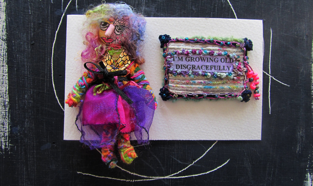 """""""I'm growing old disgracefully …"""" a mixed media card by fiber artist Scrappy Annie."""