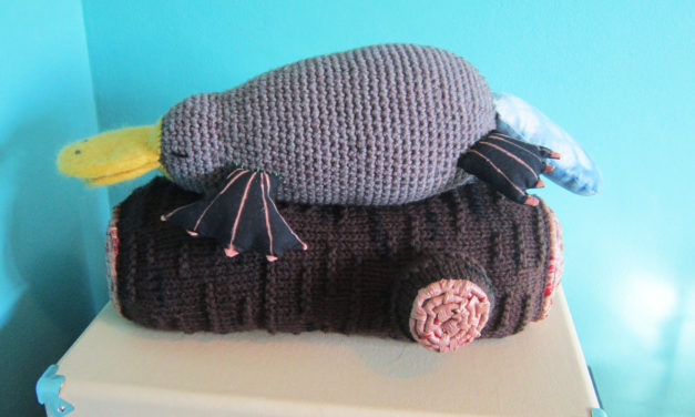 She Knit a Platypus on a Log … Part Bird, Part Mammal, Part Reptile … on a Log.