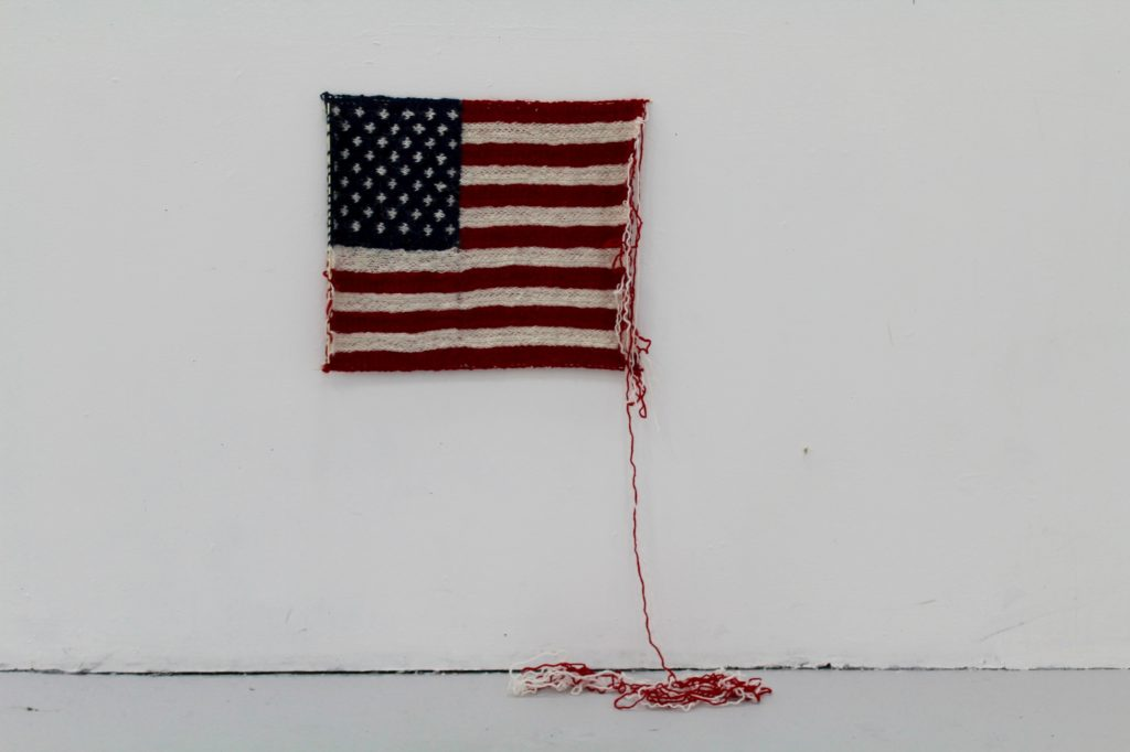 Unraveling Knitted American Flag, 'When Donald J. Trump Won the American Election' - By Danish Artist Maria Victoria Høvring Høeg