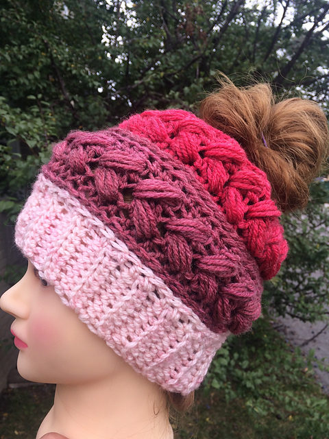 This Puffy Braids Messy Bun Hat by Jen Causley Uses Colorful Cake Yarn! Get the Pattern, So Fun – YUM!