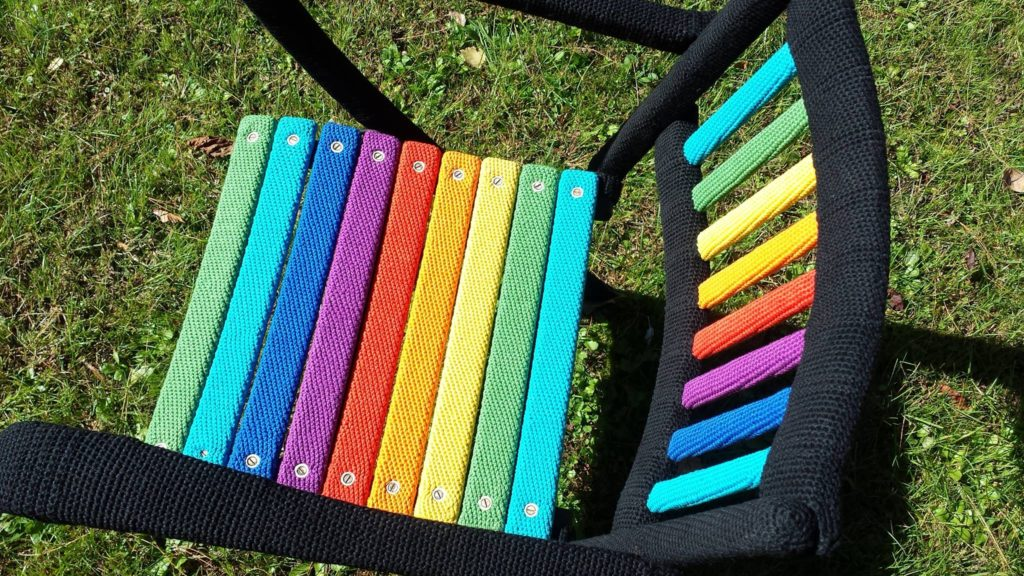 Behold the Rainbow Chair - This Is How You Yarn Bomb a Chair!