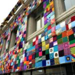 She Covered a 130-Year-Old Building With More Than 1000 Knit & Crochet Squares!