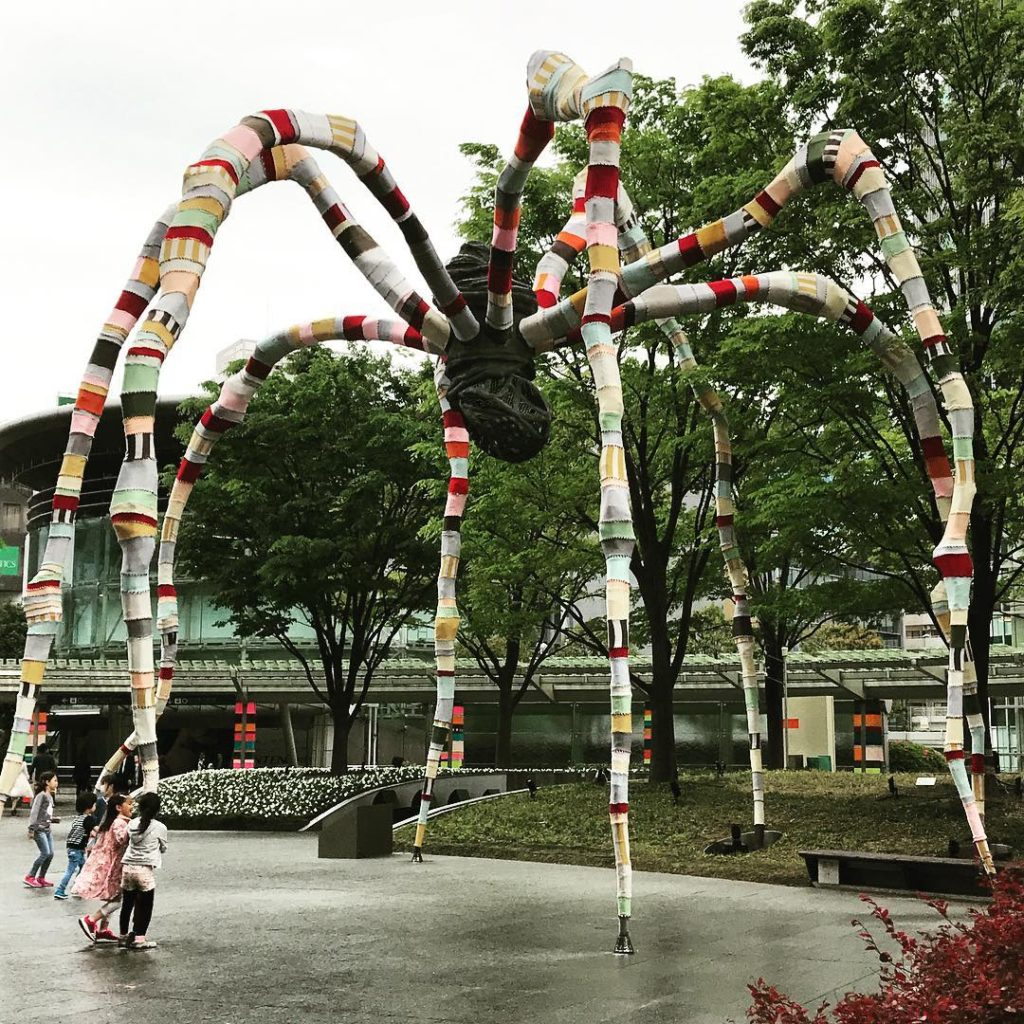 Louise Bourgeois' Maman Sculpture Gets Yarn Bombed By Magda Sayeg ... Photo by Yuko Kitamoto