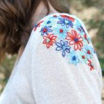 Brighten Up Any Sweater With These Simple Embroidered Flowers