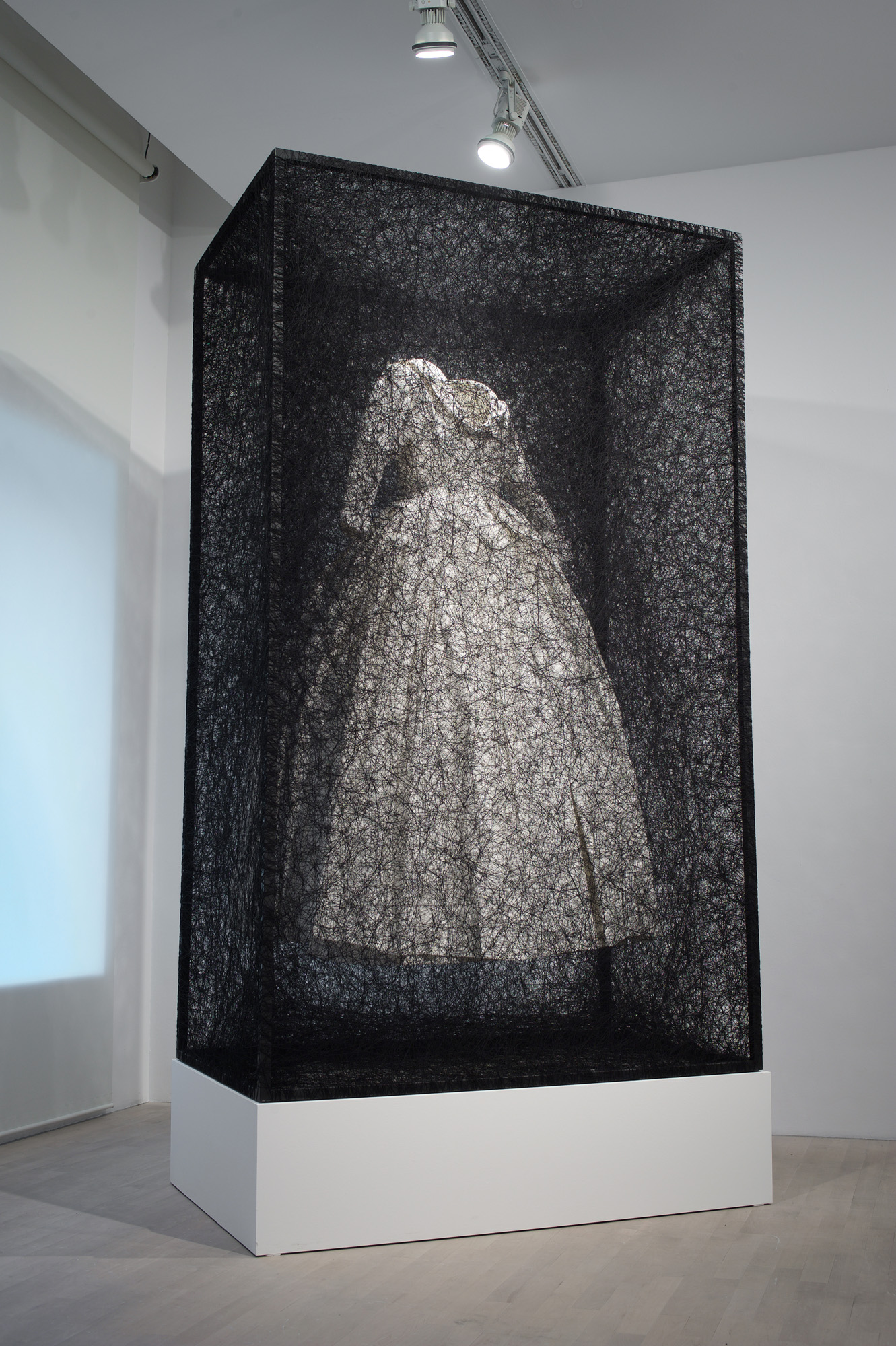 Chiharu Shiota's 'State of Being' - White Dress Entombed in a Web of Black Thread