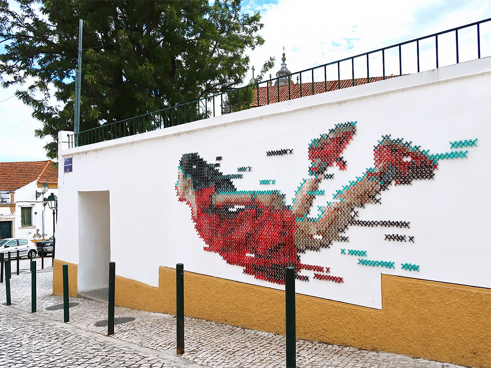 It Took 2,300 screws & 700 Meters Of Yarn To Bring This Cross-Stitch Mural To Life ... Street Art At Its Best!