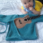 Knit a Clever Air Guitar Wrap-Around Cardigan For a Baby