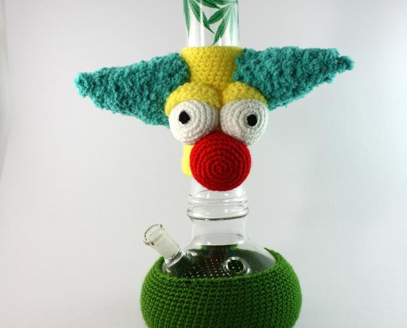 It's a Crochet Krusty The Clown Bong Cozy!