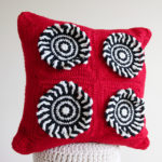 Crochet a Red Rum Cushion With This FREE Pattern Designed By Leonie Morgan