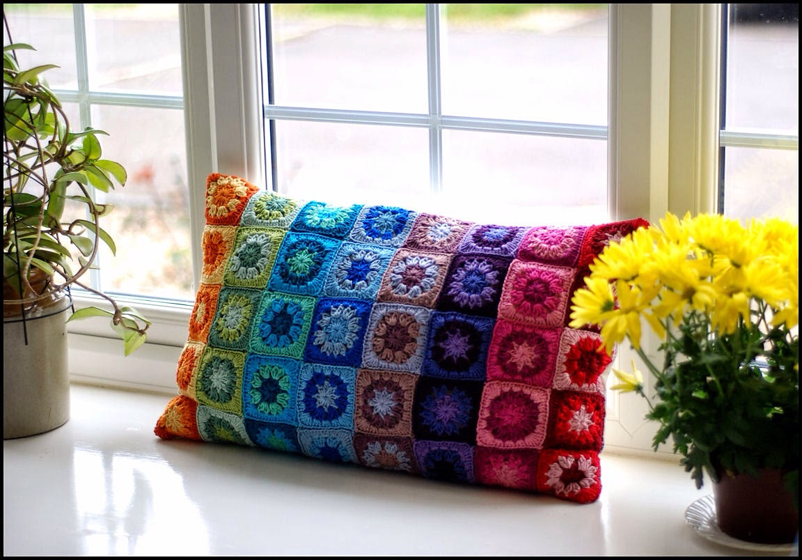 Brighten Up Any Room With This Colorful Granny Square Pillow, The Pattern Is FREE!
