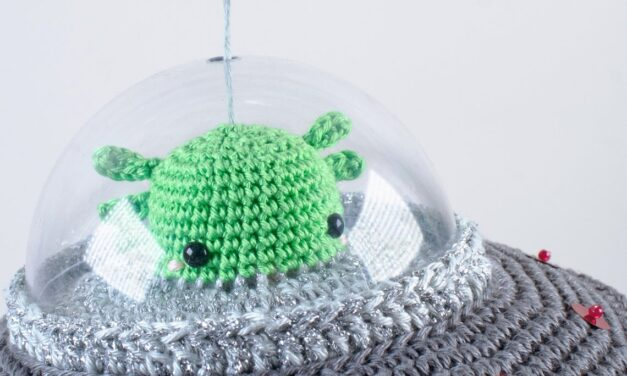 This Crochet Flying Saucer Kit Features an Alien and a Cow and It's a Wind-Up Music Box!