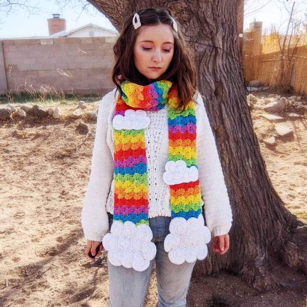 Crochet a Clever Rainbow and Clouds Scarf ... The Clouds Are Handwarmer Pockets!