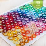 Crochet a Colorful Little Lily Baby Blanket Designed By Kirsten Ballering