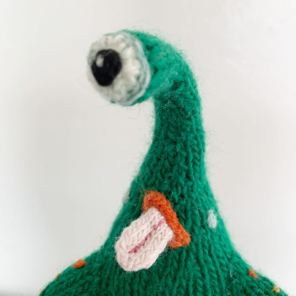Knit A Kooky Cool Cyclops Monster With A Pizza Slice ... You Know You Have To!