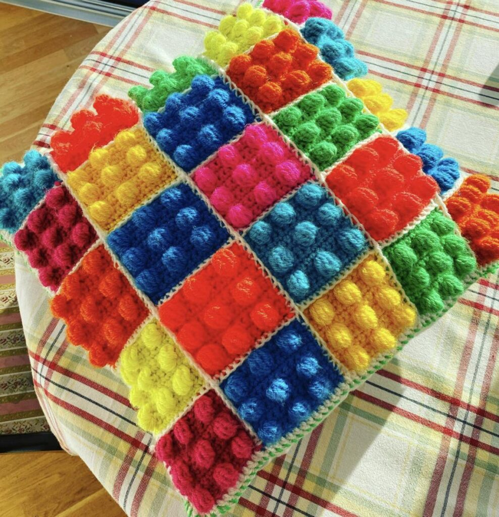 The Nicest Lego-Inspired Cushion Ever, Love The Colors! You Can Crochet Your Own or Buy One Already Handmade!