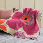 Gorgeous and the Pattern is FREE … Crochet a Stunning C2C Pop Art Flowers Afghan Or a Knit Dazzling Bloom-Inspired Pillow